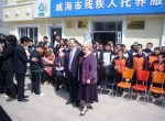 Mayor and Andrew North with Weihai children - April 2012